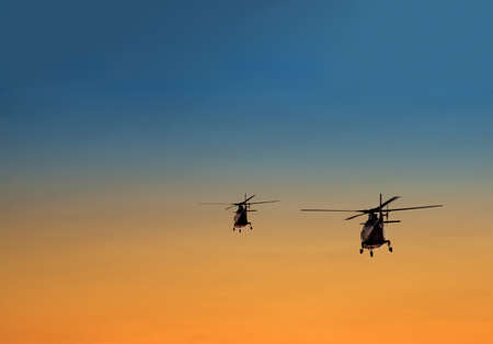 silhouette of two helicopters over summer sunset Stock Photo - 16688989