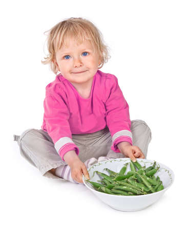 small girl with grean peas on white background Stock Photo - 16671948