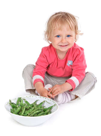 small girl with grean peas on white background Stock Photo - 16671951