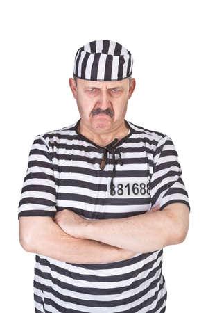 preso: retrato de un prisionero enojado sobre fondo blanco Foto de archivo