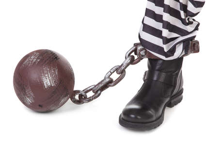 ball and chain: prisoners leg and ball and chain on white  Stock Photo