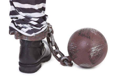 prison ball: prisoners leg, view from behind