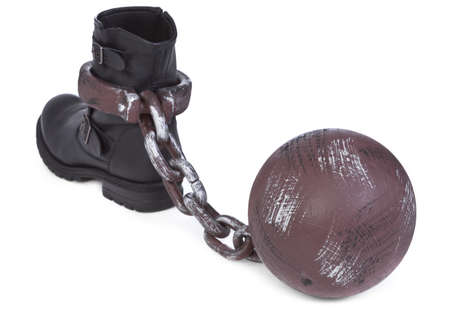 indebted: shoe and ball and chain on white