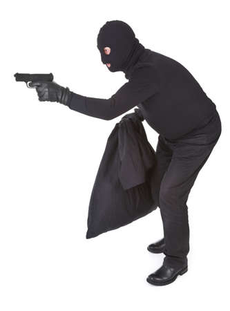 robber aiming with his gun isolated on white photo