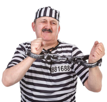 restraining device: prisoner is struggling with handcuffs over white background