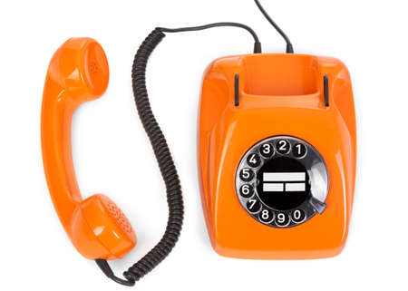top view of bakelite rotary phone on white background