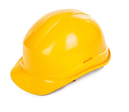 yellow hard hat on white background, small natural shadowo under object photo