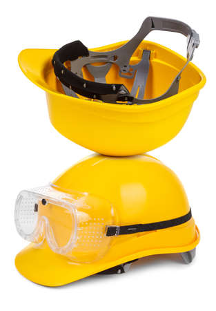 two yellow hard hats on white background photo