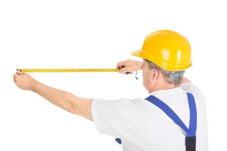 cinta metrica: trabajador con cinta m�trica sobre fondo blanco Foto de archivo