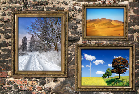 Wooden frames with beautiful landscapes over ruined brick wall, photos inside frames are my property and available in my portfolio. Stock Photo - 26550831