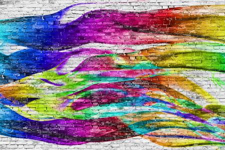 abstracte kleurrijke schilderij op een witte bakstenen muur