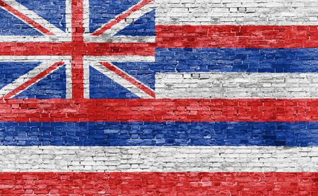 Vlag van Hawaï geschilderd op bakstenen muur