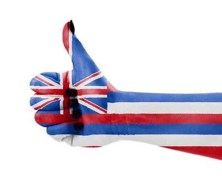 Vlag van Hawaï over de hand van de vrouw Stockfoto