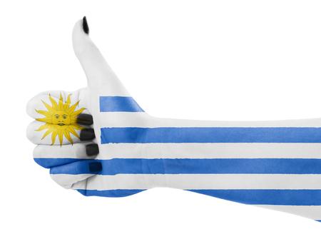 Vlag van Uruguay op vrouwelijke hand Stockfoto