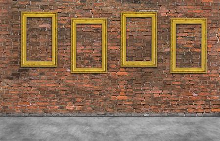 Vier gouden kaders op bakstenen muur Stockfoto
