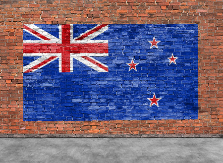 Vlag van Nieuw-Zeland geschilderd op bakstenen muur en een deel van de voorgrond