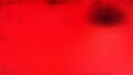 Bright Red Water Droplet Background Stock Photo