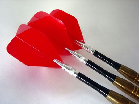 3 darts with red fins photo