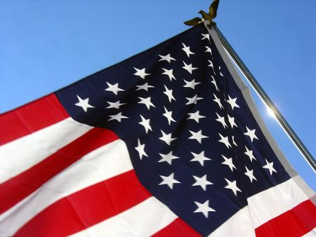 the american flag on a pole with an eagle on top Stock Photo - 421278