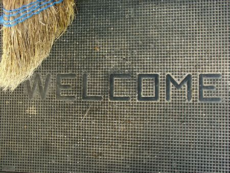 a welcome mat and a broom