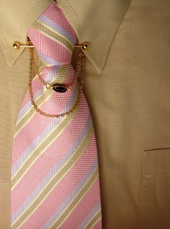 a tan colored shirt and a pink striped tie