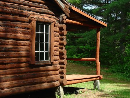 scouting: the side and porch on a log cabin Stock Photo