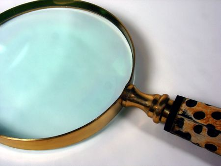 a magnifying glass with a spotted handle