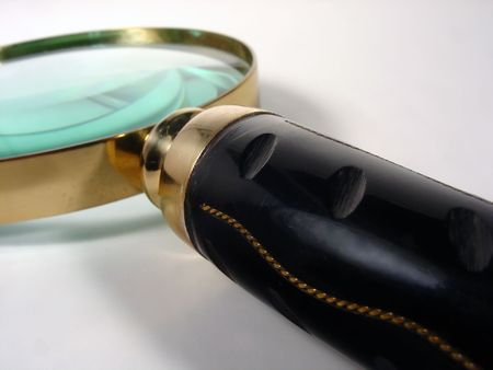 detect: a magnifying glass with a horn shaped handle