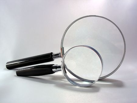two magnifying glasses - one small and one large