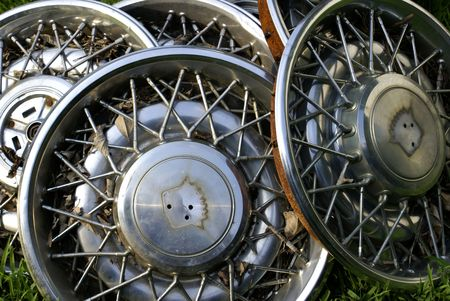 a pile of old hubcaps