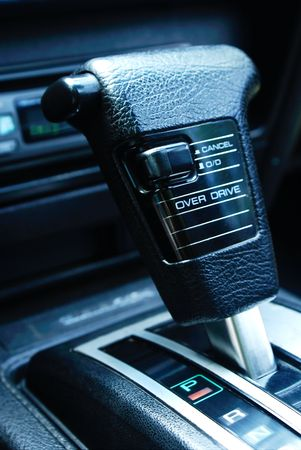 overdrive:  a gear shifter in a sports car