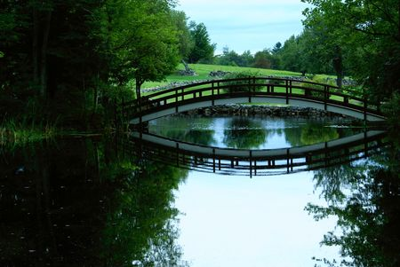 foot bridge: a small foot bridge over a pond Stock Photo