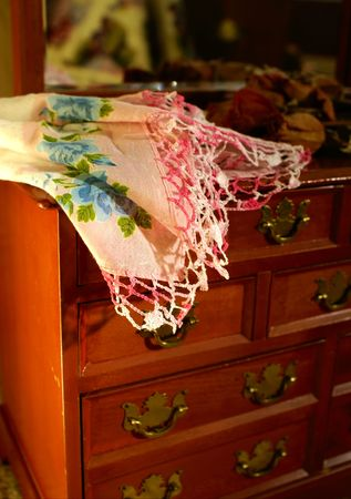 a jewelry chest with a handkerchief on top of it photo