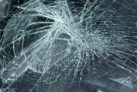 a broken windshield of a car in an accident Stock Photo