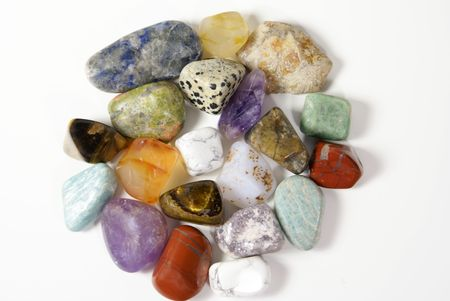 polished: a pile of colorful polished rocks isolated on white Stock Photo