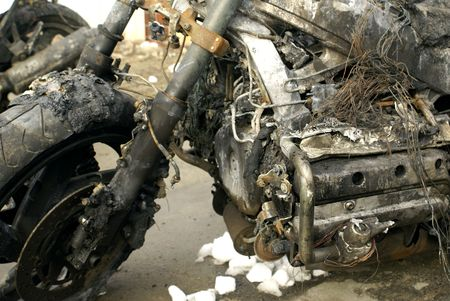 a motorcycle that was damaged in a fire photo