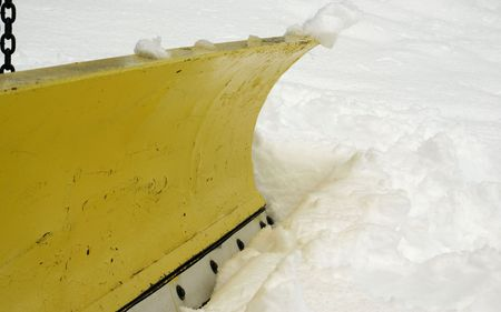 plows: a macro of a blade on a snow plow truck
