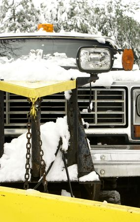 a snow plow truck with a yellow plow photo