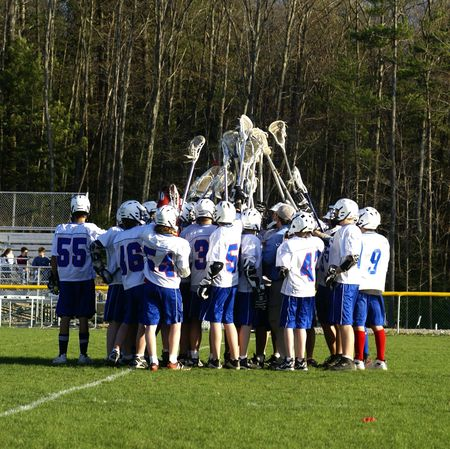 huddle: a high school lacrosse team at a match Stock Photo