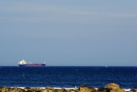 a large tanker boat heading out to sea  Stock Photo