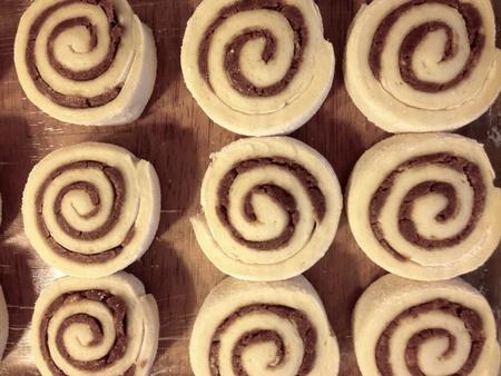 Raw cinnamon rolls in a baking dish