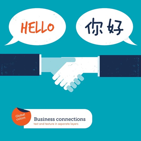 English and Chinese handshake with speech bubbles saying hello Reklamní fotografie - 123329493