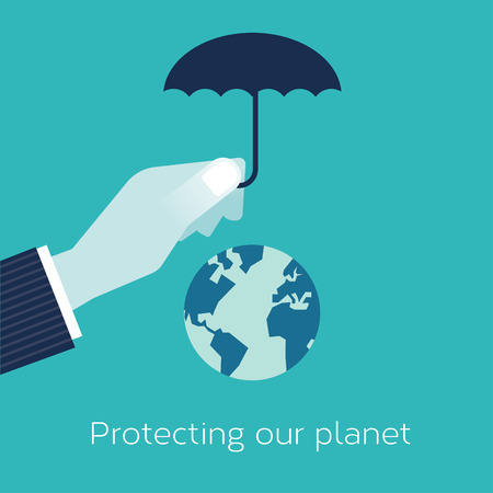 Businessmans hand holding an umbrella over our planet to protect it.