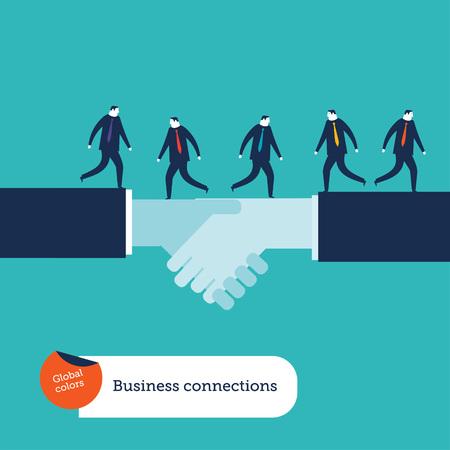 business relationship: Businessmen walking on a handshake