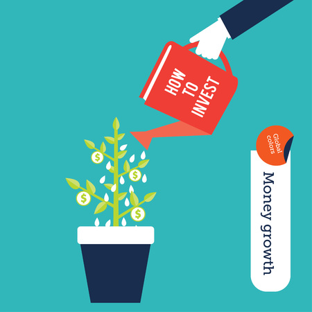 Money making concept, human hand watering a  plant with a book to bring in success in investments