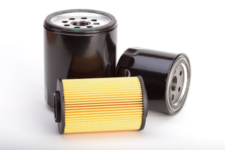 Three types of oil filters on a white background Stock Photo