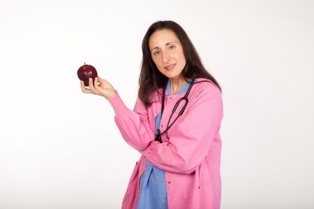 health care provider: Health care provider doctor suggests an apple for healthy living