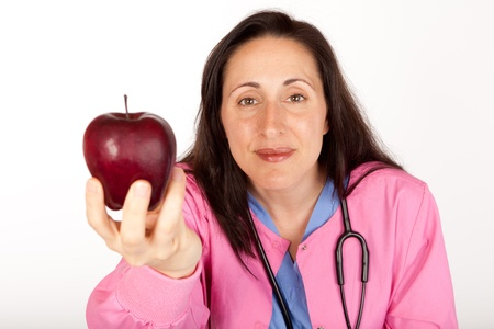 suggests: Health care provider doctor suggests an apple for healthy living