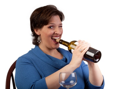 Woman pulling a wine cork out with her teeth