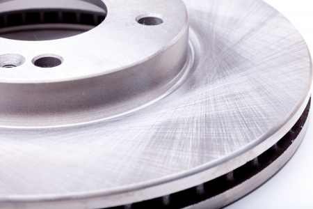 Studio shot of a front brake disk for a modern car isolated on a white background Stock Photo